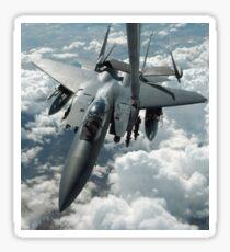 An F-15 E Strike Eagle receives fuel from a KC-10 Extender. Sticker
