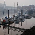 Whitby harbour in the mist by dougie1