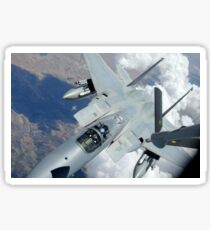 An F-15 Eagle pulls away from a KC-135 Stratotanker after refueling. Sticker