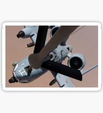 An A-10 Thunderbolt II receives fuel from a KC-135 Stratotanker. Sticker