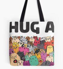Hug a dog Tote Bag