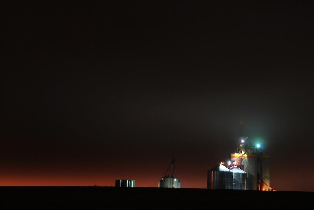 a pioneer grain elevator at night by matttatts