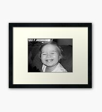 grin Framed Print