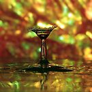 colored martini glass splash by Don Cox