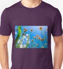 Abstract view of flowers on lovely blue cloudy sky background. Unisex T-Shirt