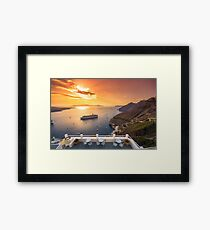 Amazing evening view of Fira, caldera, volcano of Santorini, Greece with cruise ships at sunset. Cloudy dramatic sky. Framed Print