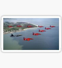A F-22 Raptor flies in formation with the Royal Air Force Aerobatic Team, The Red Arrows. Sticker