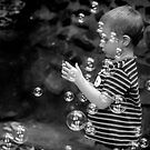 The Boy, the Bubbles and a Party Ring by Clare Colins