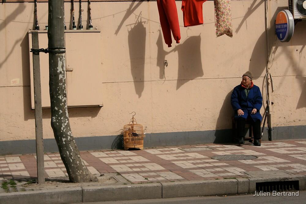 Old man alone in the street by Julien Bertrand