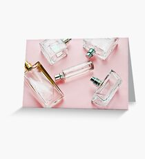 Beautiful bottles dehami on a gentle pink background Greeting Card