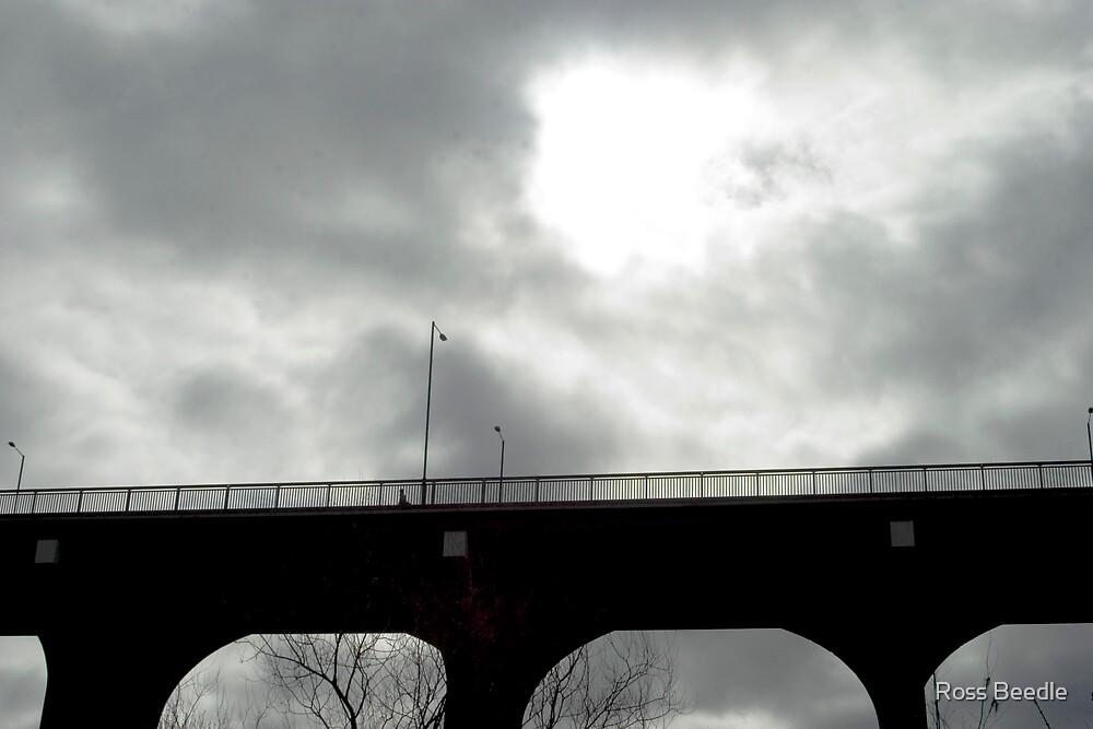 Lone figure on bridge : moody sky by Ross Beedle