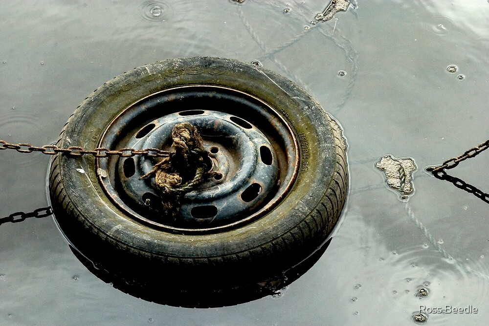 Tyre in river  by Ross Beedle