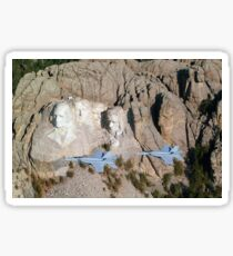 Two F/A-18E Super Hornets conduct a fly by of Mount Rushmore. Sticker