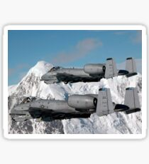 A-10 Thunderbolt II's fly over mountainous landscape. Sticker