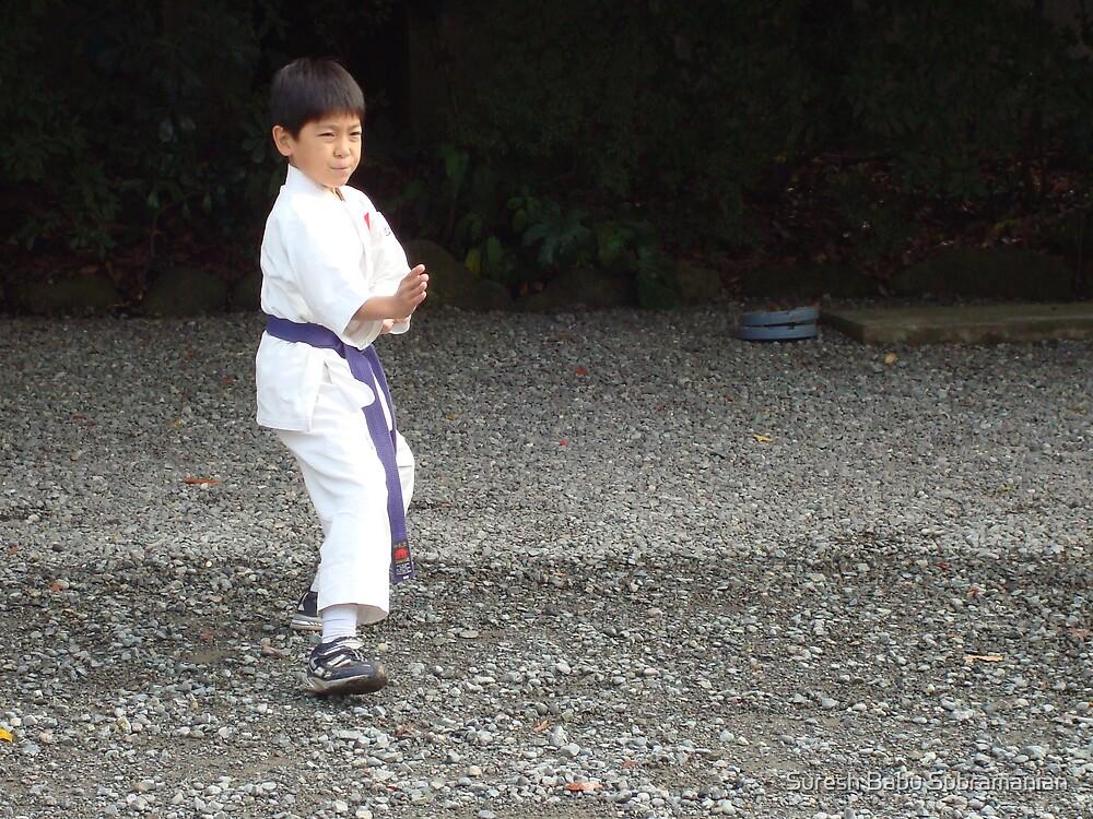 A Japanese Kid At Karate Demonstration by Suresh Babu Subramanian