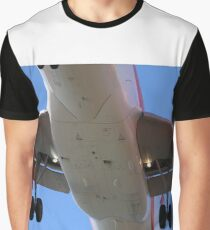 The belly of a plane 60 feet over your head landing Graphic T-Shirt
