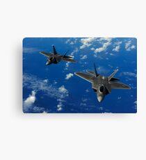 U.S. Air Force F-22 Raptors in flight near Guam. Canvas Print