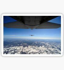 Two EC-130J Commando Solo aircraft fly in formation. Sticker