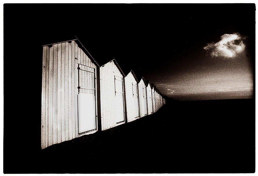 beach huts at rest by ragman