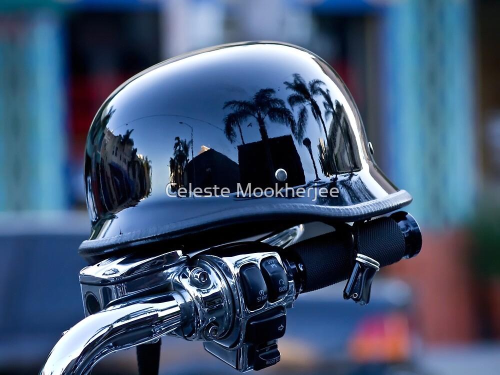 Motorcycle handlebar with reflective helmet by Celeste Mookherjee