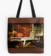An Old Wheelbarrow, An Ancient House Tote Bag