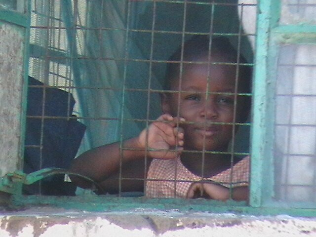 Little girl gazing from the window by sunnymombasa
