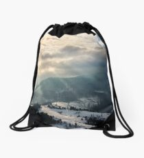 stormy weather over village in mountains Drawstring Bag