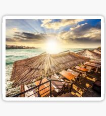 restaurant place at the sea shore at sunset Sticker
