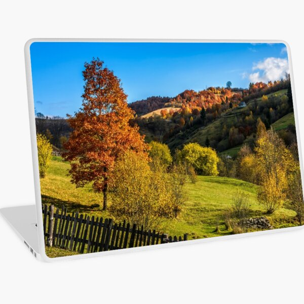 red tree  behind the fence on hillside Laptop Skin