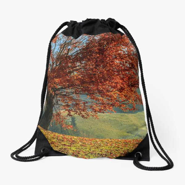 red tree in front of spruce forest in fog Drawstring Bag