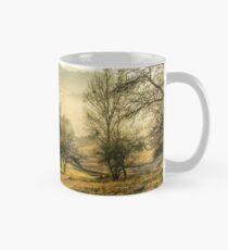 autumn forest on hillside in fog Mug