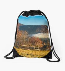 foggy and hot sunrise in Carpathian mountains Drawstring Bag