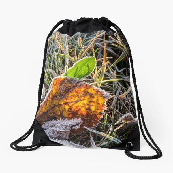 yellow and green foliage in the grass Drawstring Bag