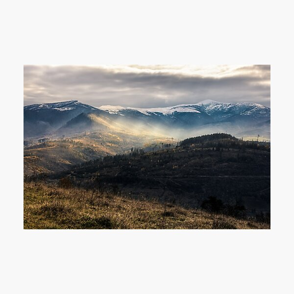 snowy peaks over hillsides in fog Photographic Print