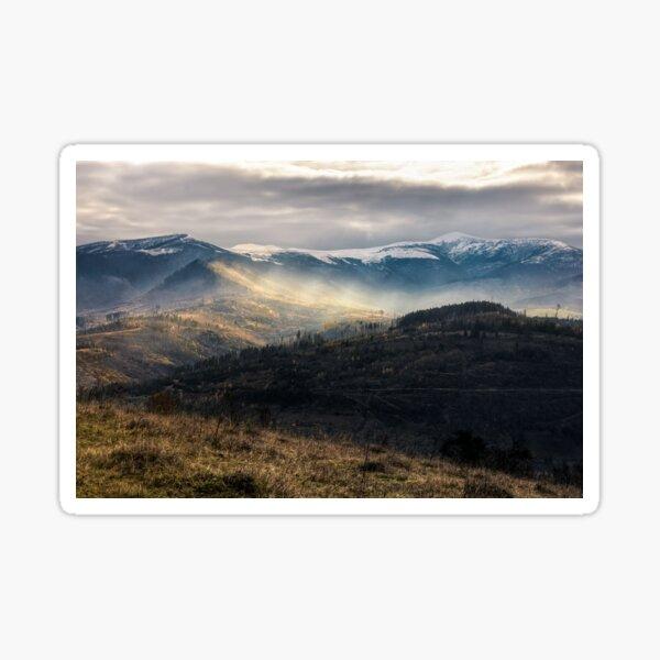 snowy peaks over hillsides in fog Sticker