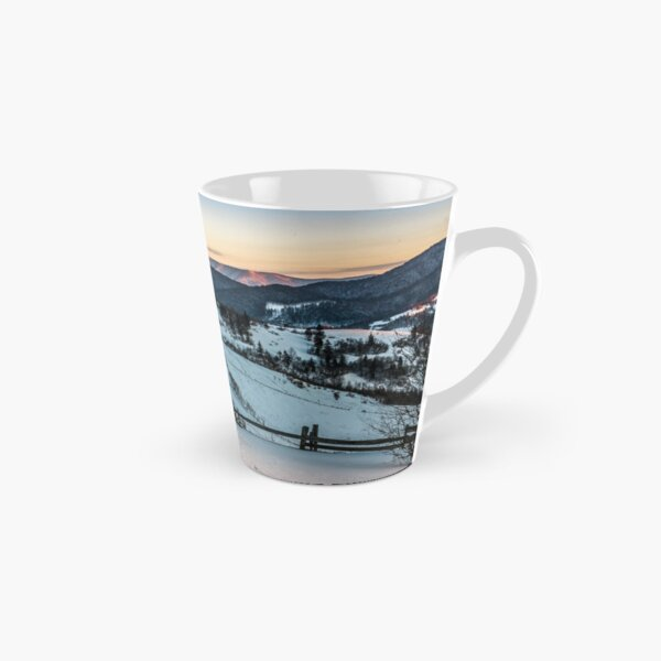 fence on snowy mountain slope near the forest in winter Tall Mug