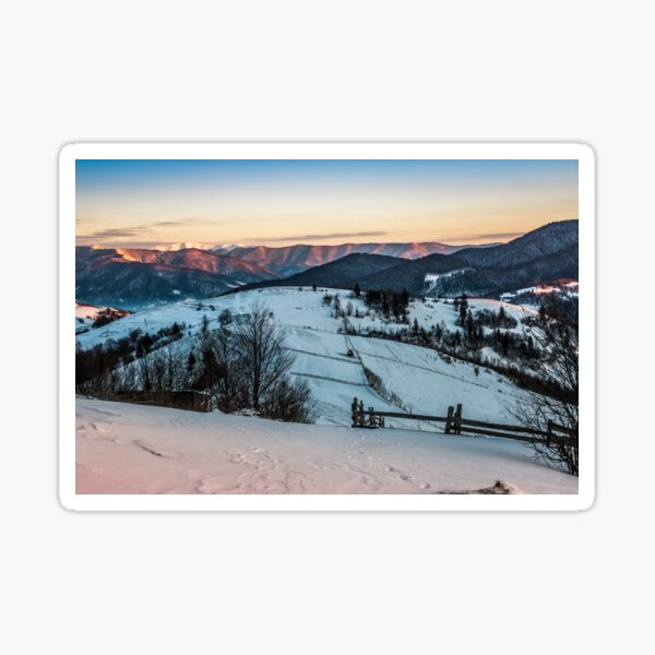 fence on snowy mountain slope near the forest in winter Sticker