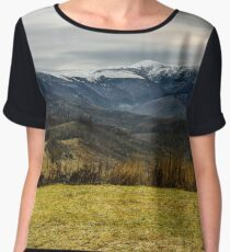 fence on the meadow in snowy mountains Women's Chiffon Top