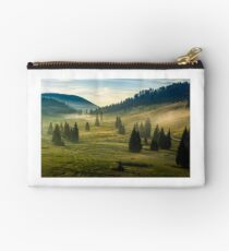 spruce forest on a hill side in fog Studio Pouch