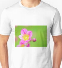 Macro pink flawer on green background Unisex T-Shirt