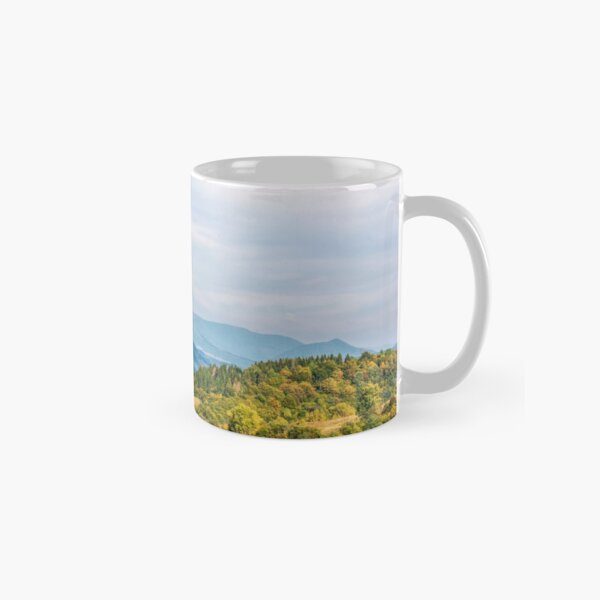 trees on a hill side near the mountain road Classic Mug