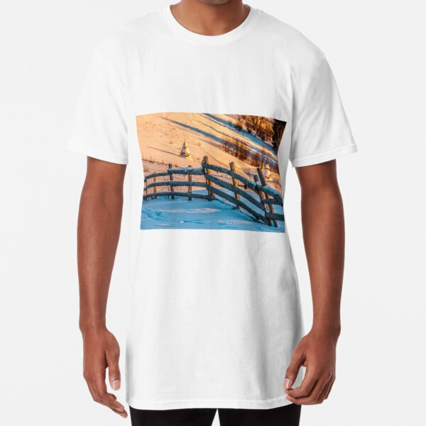 fence on snowy mountain slope near the forest in winter Long T-Shirt