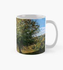 tree near valley in mountains Mug