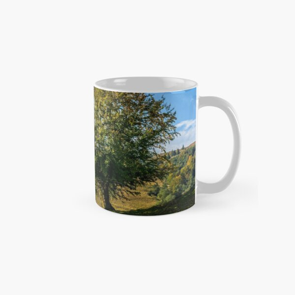tree near valley in mountains Classic Mug