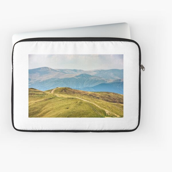 road through a meadow on hillside Laptop Sleeve
