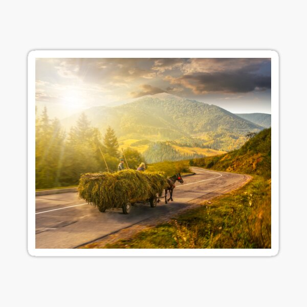 cart with hay on the way to mountains at sunset Sticker