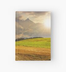 rural field in Tatra mountains  at sunset Hardcover Journal