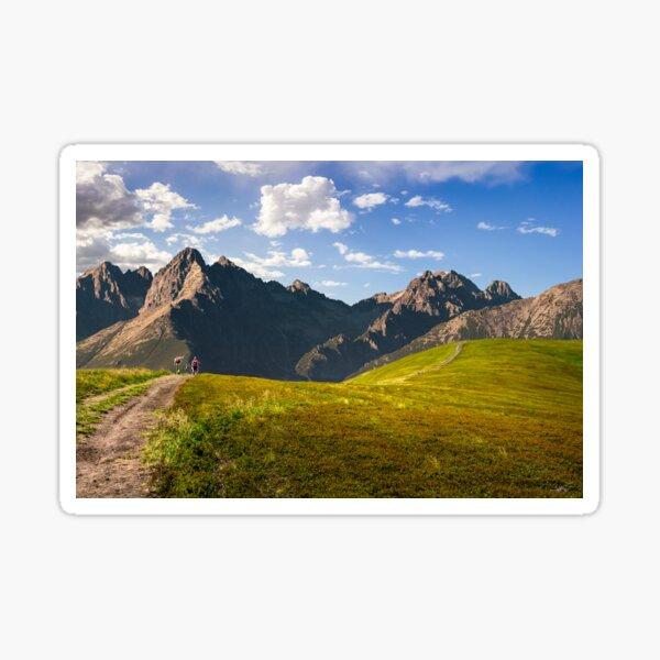 Hillside path to mountain peaks Sticker