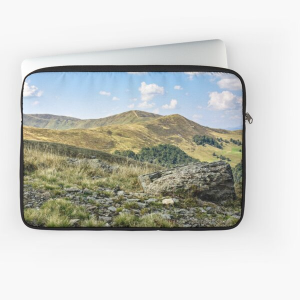 mountain landscape with stones in the grass on hillside and blue sky Laptop Sleeve