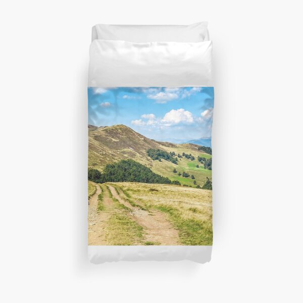 road through a meadow on hillside Duvet Cover